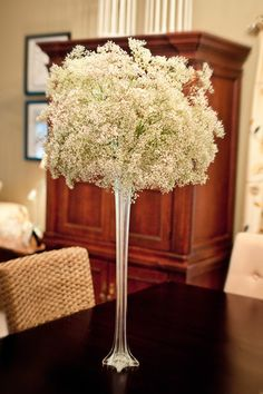 Babysbreath. They have these tall think vases in Enfield for about £4