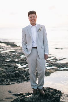 Groom by the ocean | What A Day! Photography
