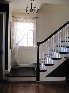 Russet Street Reno stairway redo - they removed carpet, sanded and re-stained the stair treads, and fixed up the banister. Wow!