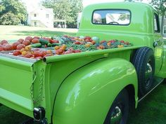 a green truck load of fresh vegetables