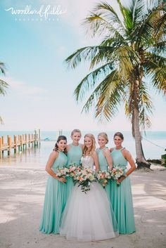 Woodland Fields Photography | Islamorada The Keys Florida Wedding Photographer | bridesmaids in light aqua pool long dresses tiffany blue | succulents ranunculus greenery bouquets