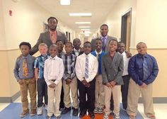 Elementary school kids put on suits and ties and learn lessons in life that will help them succeed as men.