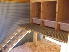 I like this idea for nest boxes because they are easily slid out and cleaned:)