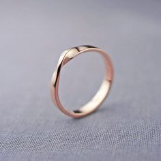 This rose gold diamond promise ring set is crafted in solid rose gold with a round cut natural diamond. There is nothing like a gorgeous unique diamond engagement rings to set her heart aflutter. Mobius Ring, Bijoux Design, Ring Set, Handmade Wedding, Recycled Wedding, Beautiful Rings, Wedding Bands, Gold Wedding, Wedding Ring