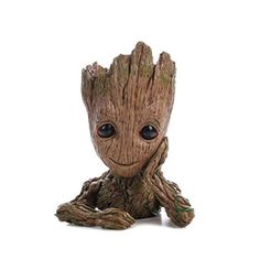 An incredible showpiece version of 'Baby Groot' from the hit movie 'Guardians of the Galaxy Looks like all carved in a piece of wood. It's made of hard plastic, Cute Office Supplies, Fern Plant, Peacock Bird, Bird Ornaments, Flower Branch, Baby Groot, Star Lord, 2nd Baby, Pen Holders