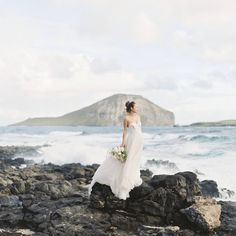 Sea-side ceremony meets dreamy details. (link in bio to shop the Rowland Gown | #regram @elope_in_hawaii 📷: @aliceahnphotography)