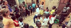 Volunteer in Kenya teaching music with IVHQ