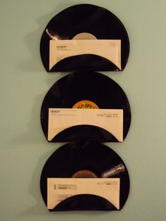 Re-purposed Vinyl Record Mail Holders, just heat and bend into shape.