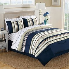 Instantly update your bedroom with the clean and crisp Ellsworth Comforter Set. The plush bedding features a refreshing navy, red, white and khaki stripe pattern, perfect to liven up your bedroom's decor.