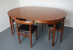 Dining table and chairs by Hans Olsen for Frem Rojle. Afromosia? I LOVE this.