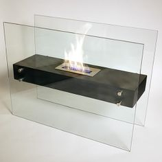 Freestanding Ethanol bio-fireplace. No venting required. Love, love, love this! Prices seem reasonable, too.