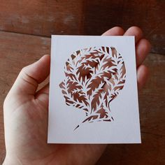 Papercut silhouettes, kind of like a twist on those cut-out paper snowflakes I made as a kid