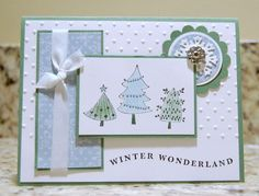 "Stamps: Cute Christmas and ?. Ink: Basic Black, Baja and Garden Green. CS: Garden Green, Whisper White. DSP: Candy Cane Christmas. Punches: Scalloped Circle, 1- 3/8"" Circle, 1-1/4"" Circle. Big Shot: Polka Dot Embossing Folder, Snowflake Strip. Accessories: Markers, Daubers, White Taffeta Ribbon, Filigree Brads. To color the trees create a mask and use daubers to color - then add a little accent with the markers."