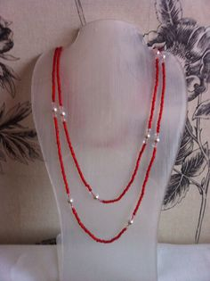 Necklace. red seed beads, crystals and silver beads.