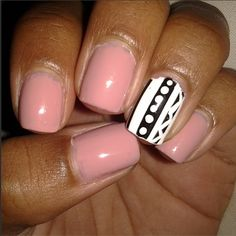 Soft pink nail art with black-and-white accent nail.
