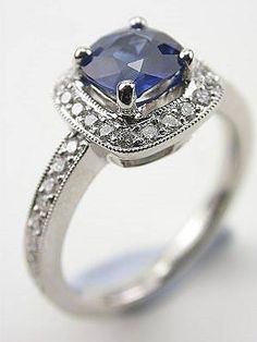 Cushion Cut Blue Sapphire Engagement Ring not only is it BEAUTIFUL but my birthstone as well :)