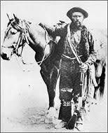 """Gabriel Dumont, Métis war chief and hivernant buffalo hunt brigade leader. Photographed at Fort Assiniboine, Montana Territory, May 25th - 29th, 1885, seeking asylum following the 1885 resistance and fighting at Batoche, NWT, after escaping capture by the Canadian government, with his famous grey """"buffalo runner"""" horse and holding """"Le Petit"""" his 1873 Winchester rifle. From: """"Gabriel Dumont: Li Chef Michif In Images And Words"""" by Darren Prefontaine, Gabriel Dumont Institute, 2011. JE"""