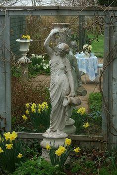garden art...love the effect of the mirror behind statue