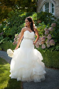 Bride Caitlin is stunning in this Anne Barge dress with a dramatic skirt