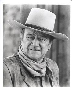John Wayne -  my husband loved watching him.  Both are gone now,
