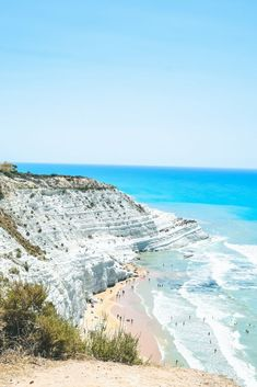 """A natural wonder of the world: Scala Dei Turchi bathes in sunlight and is surrounded by seductive blue, turquoise and azure waters and endless pebbly beaches and private, rocky, seaside nooks along the coast. You know when you see one of those dream travel destinations on Instagram and think to yourself—""""OMG, where is that?! I have to go there.""""—well, Scala dei Turchi or the Turkish Steps in Agrigento, Sicily is one of those locations. Read about the #1 must-visit beach on travel blog…"""