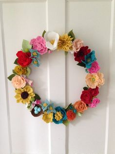 Items similar to Think Spring!: 12 inch Felt and Yarn Wreath on Etsy Items similar to Think Spring!: 12 inch Felt and Yarn Wreath on Etsy Felt Crafts Diy, Wreath Crafts, Diy Wreath, Flower Crafts, Fabric Crafts, Felt Roses, Felt Flowers, Diy Flowers, Fabric Flowers