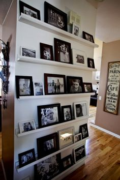 Floor to ceiling floating shelves used to display portraits!  Mix and match and change them up whenever you want!