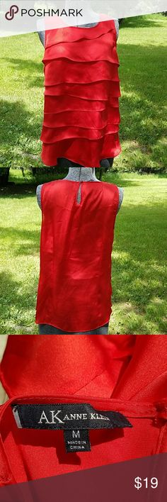 Anne Klein Blouse Beautiful textured true red blouse. GUC 100% polyester. Runs a bit small because it does not stretch. Best for size 4 to a small size 8. Anne Klein Tops Blouses