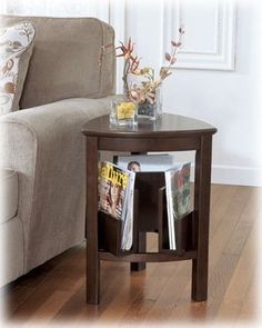 Triangle End Table in Dark Brown - Signature Design by Ashley Furniture by Ashley. $132.36. Console features framed door with mirror panel. T654-0 large cocktail table features a shelf and 3 drawers.. Tables made from select birch veneers and hardwood solids in a dark brown finish. Decorative hardware with brushed nickel color finish. Tables made from select birch veneers and hardwood solids in a dark brown finish. Console features framed door with mirror panel. Dec...