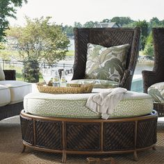 "Love the round cushion on this ottoman/day bed. And the feature cushion in Palm leaf really makes this outdoor area ""pop"". We sell similar fabric online so anyone can recreate this look."