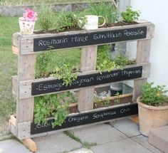 Pallet Herb Garden Idea -- I like the idea of using chalkboard paint so you can identify everything!