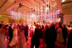 7 Ideas for Hanging Ceiling Decorations - Suspended Crystal Strands over Dance Floor - mazelmoments.com