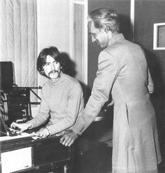"""George seated at the Lowrey organ playing to an Indian musician. Photo taken on 3rd March & no sessions for """"Within You Without You"""" are recorded for this day. Sgt Pepper, 1967"""