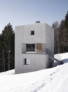 Rising from the hillside like a modern monolith is a small Mountain Cabin designed bymarte.marte architects. The narrow home is three-stories and co...