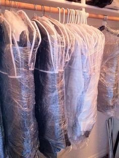Tips for packing hanging clothes for a move... use plastic wrap and then zip tie the hangers together.