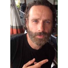 black t shirt, finger and the beard...dont get better than that!