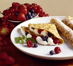 Palatschinken: a Crepe like egg dough creation filled with berries or ...