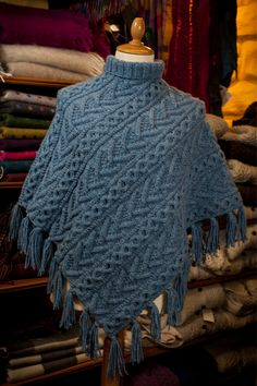 Hand knit Aran stitch poncho. Made in Ireland.