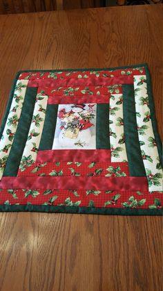 Sure to add that Holiday touch on your table. Log Cabin with Snowman in the center. Can be machine washed gentle cycle and Line Dryed or delicate cycle in dryer. Back is solid off white. Size is 18 X 16 Quilted Table Runners Christmas, Christmas Placemats, Christmas Runner, Table Runner And Placemats, Table Runner Pattern, Thanksgiving Table Runner, Christmas Log, Christmas Sewing, Christmas Crafts