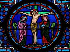 Stain glass window showing station of the cross. (crucifixion) in romanesque church.