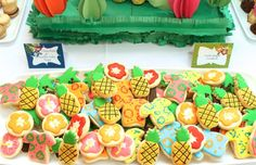 Aloha everyone! We are loving this Luau dessert table that Nikki created for her daughter's 5th grade dance. The fabulous background design was made of giant crepe paper flowers and was inspired by vintage Hawaiian postcards. We love how Nikki cut paper to look like fruit and how she made the the fringe serving pieces from construction paper. …