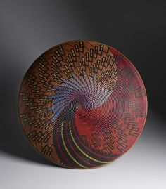 This is not woven it is a wood carving by David Nittman