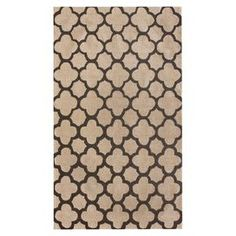 Hand-hooked wool rug with a quatrefoil trellis motif.   Product: RugConstruction Material: WoolColor: Beige and brownFeatures: Hand-hookedNote: Please be aware that actual colors may vary from those shown on your screen. Accent rugs may also not show the entire pattern that the corresponding area rugs have.