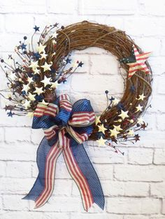 Patriotic Wreath, Americana Wreath,  4th of July Wreath, Rustic Red White and Blue Wreath,  Memorial Day Wreath, Grapevine Patriotic by Dazzlement on Etsy https://www.etsy.com/listing/272562536/patriotic-wreath-americana-wreath-4th-of