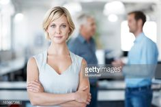 Stock-Foto : Confident woman with arms crossed