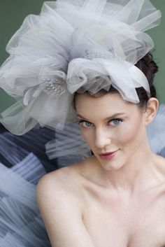 LANDREE – Ethereal boho bridal headband fascinator. Billows of asymmetrically folded silver- gray tulle mix with #feathers and loops of white French net veil $195 http://thefeatheredhead.com/products/landree