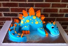 dinosaur - Big blue dinosaur cake. RKT head the rest is cake covered in fondant.