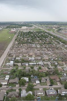 File:Shown here May 21, 2013, is an aerial view of tornado damage in Moore, Okla 130521-Z-BB392-461.jpg