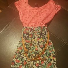 Cute summer dress from Rueda 21. Very cute and made with light weight material.  The top is a a knitted fabric and is pinkish/coral in color Dresses Midi