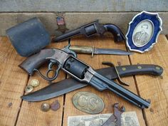 Front: 1861 Savage Navy, complete with Military Inspector marks, issued revolver.  Back: 1861 Uhlinger Serial #14